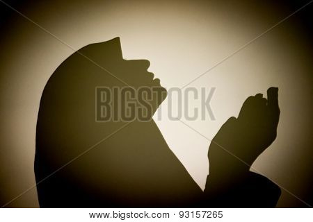 Muslim woman praying abstract silhouette