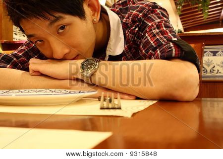 Portrait Of A Asia Man Bend On The Table