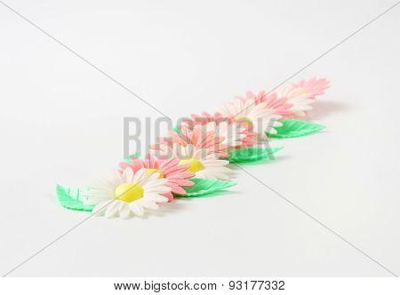 sugar flowers - eatable cake decoration on white background