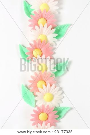 sugar flowers - eatable cake decoration on white background