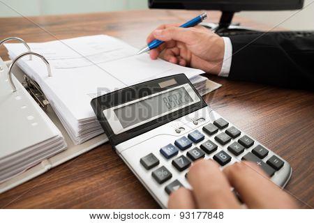Businessman Calculating Invoice