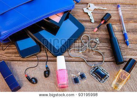Blue women's purse. Things from open lady handbag.