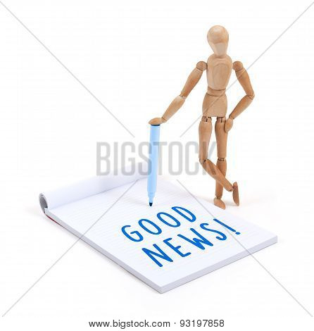 Wooden Mannequin Writing In Scrapbook - Good News