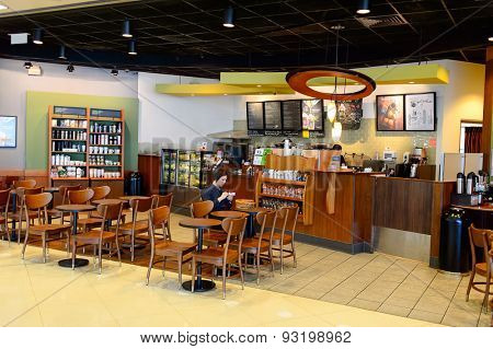 HONG KONG - JUNE 04, 2015: Starbucks Cafe interior. Starbucks Corporation is an American global coffee company and coffeehouse chain based in Seattle, Washington