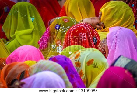 Colourful crowd of Indian women sitting together, Jaipur, India ** Note: Visible grain at 100%, best at smaller sizes