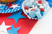 american independence day, celebration, patriotism and holidays concept - close up of glazed sweet candies with stars decoration at 4th july theme party poster