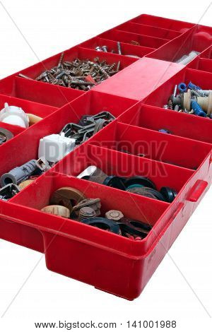 Plastic box for small ironware. Nails screws dowels. Isolated on white background with clipping path