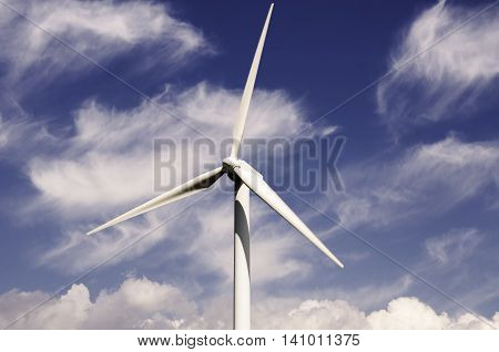 wind turbine renewable energy source in the cloud sky