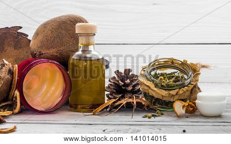 natural cosmetics environmentally friendly product aromatic cream and oil on wooden white background