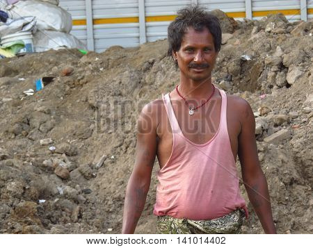 Pune, India - October 30, 2013: A portrait of a poor Indian man who works on a construction site