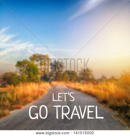 Inspirational quote : Let's go travel on blur background