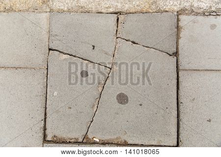 masonry and stonework concept - close up of cracked stone plate
