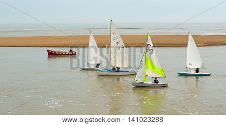 FELIXSTOWE, SUFFOLK, ENGLAND - JUNE 11, 2016: Colourful Sailing Dinghies together at the estuary of the river Deben at Felixstowe Ferry Suffolk England.
