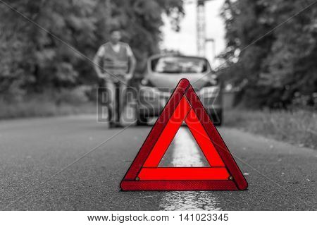 Broken Car On The Road And Red Warning Triangle