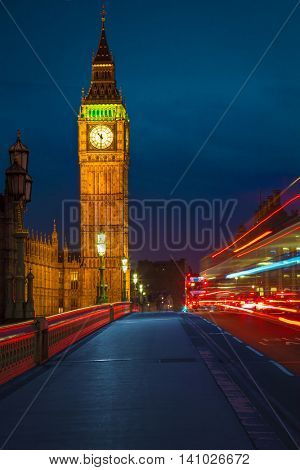 View of Big Ben from Westminster Bridge and night traffic.