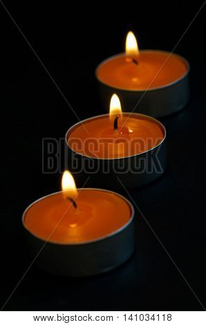orange candles lit during each party to perfume and brighten the environment
