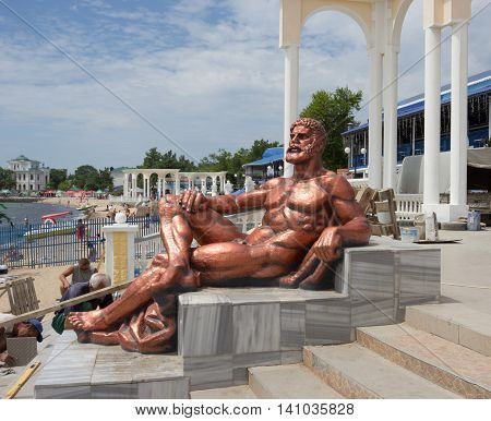 EVPATORIYA, CRIMEA - JUNE 9, 2014:Statue of Hercules on the waterfront in the center of Evpatoriya