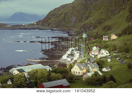 houses and campsite on a rocky coast of the sea Runde island Norway