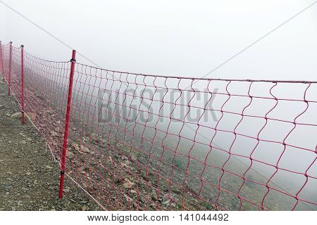Guard Fence Equipment From Red Roupe Netting Befor Mountain Abyss