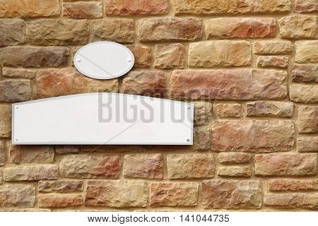 Empty White Street Signs On The Yellow Tiled Stone Wall Facade Background Close Up