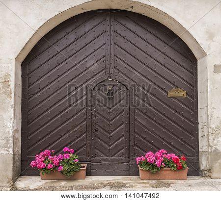 Old brown door in Borgo Villa il Poggio Piedmont Italy.