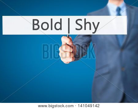 Bold Shy - Businessman Hand Holding Sign
