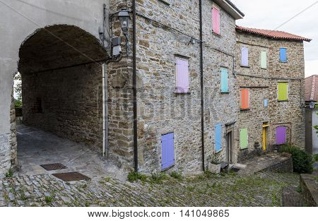 Village of Montechiaro d'Acqui in Piedmont in Italy with old houses and colored shutters.