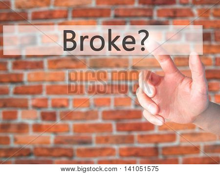 Broke - Hand Pressing A Button On Blurred Background Concept On Visual Screen.