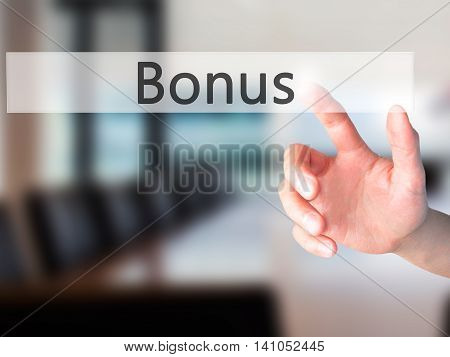 Bonus - Hand Pressing A Button On Blurred Background Concept On Visual Screen.