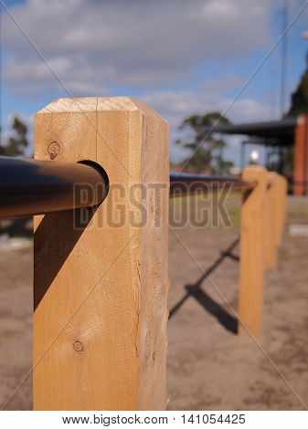 Timber barrier pole and barrier tube in a public park Australia 2016