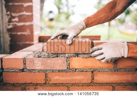 Professional Construction Worker Laying Bricks And Building Barbecue In Industrial Site. Detail Of H