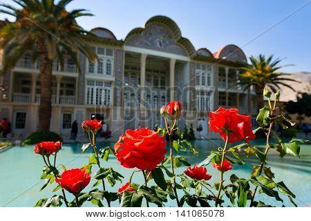SHIRAZ IRAN -APRILL 30: Qavam House at Eram Garden with red roses in Shiraz Iran on Aprill 30 2016. Eram Garden has led to its designation as a UNESCO World Heritage Site.