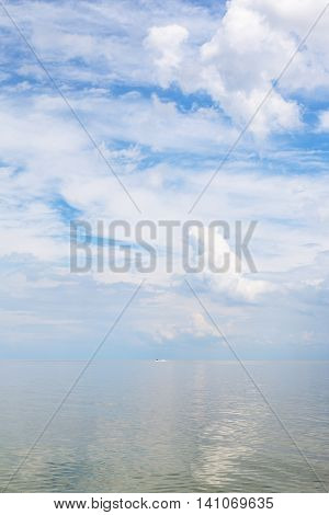 Cumuli White Clouds And Calm Water Sea Of Azov