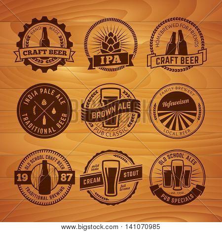 Set of vector craft beel labels. Beer logos on vintage wooden background