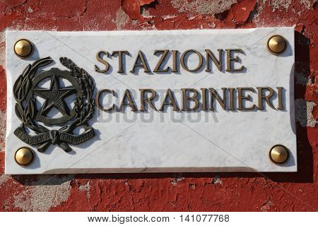 sign with the symbol of the Italian Republic and the written STAZIONE CARABINIERI who in Italian means Italian police department