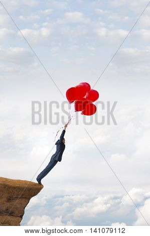 business risk concept courageous daring businessman holding balloons