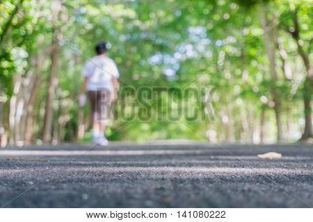Lane Blacktop and people activities in park with trees bokeh