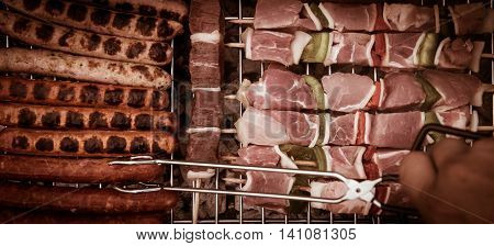 Barbecue with delicious grilled meat on grill. Meat brochettes on grill fire.
