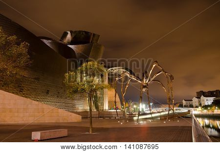 BILBAO, BASQUE COUNTRY. 29th July 2016. The giant spider, Maman, standing guard outside the Guggenheim Modern Art museum, Bilbao. Many magazines, including Vogue, have recommended Bilbao as a top destination this year.