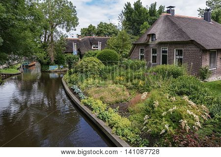 Giethoorn Netherlands - June 29: known for its bridges, waterways, thatched cottages and punters. It is also called the 'Dutch Venice' and known to the world Monopoly edition, June 29, 2016 in Giethoorn, Netherlands.