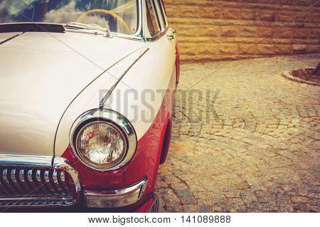 Antique vintage retro red automobile bumper car front light