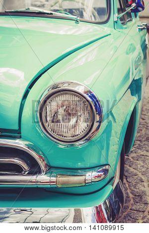 Antique vintage retro blue automobile bumper car front light