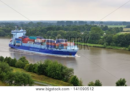 NORD-OSTSEE-KANAL, GERMANY-AUGUST 06: container ship Aurora sails into Nord-Ostsee-Kanal in Germany on August 06, 2011: Nord-Ostsee-Kanal is a shortest way from North Sea to the Baltic sea