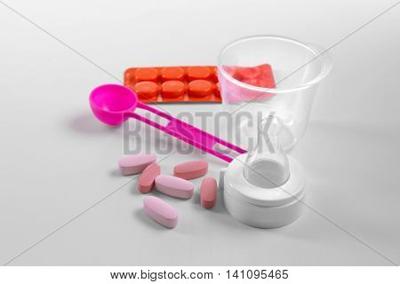 Drugs and soother on white background