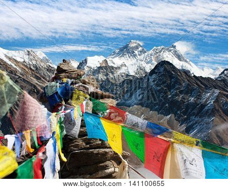 view of Mount Everest Lhotse and Makalu with buddhist prayer flags from Gokyo Ri - Nepal