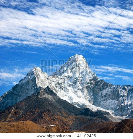 View of Ama Dablam on the way to Everest Base Camp with beautiful cloudy sky Sagarmatha national park Khumbu valley Nepal