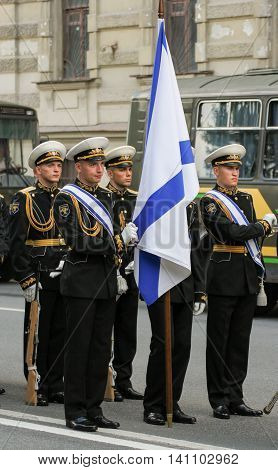 St. Petersburg, Russia - 31 July, Sailors with a flag, 31 July, 2016. Military sailors on parade in honor of the Navy.