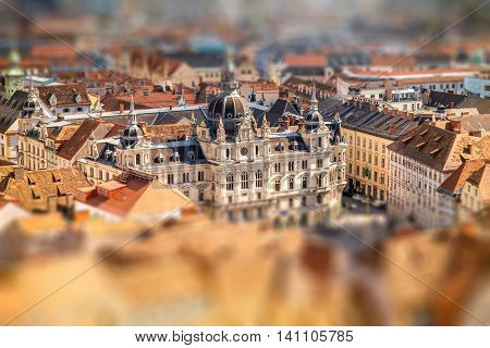 Top view on the town hall from the castle hill in Graz city. Traveling Austria. Tilt-shift image technic