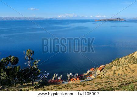 Coastal harbour village overlooking large lake and islands