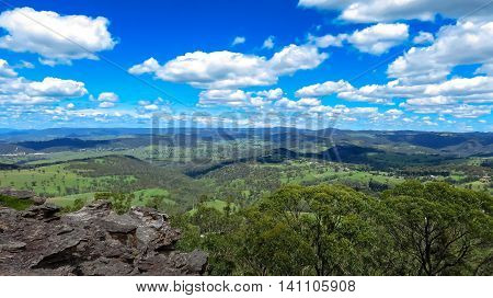 Landscape overlooking green fields and woodlands in the Australia